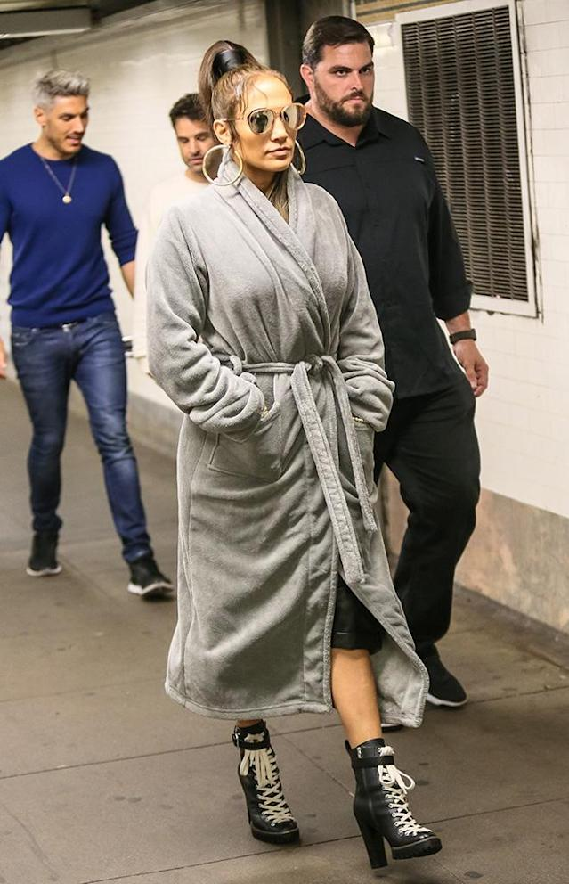 <p>Jenny from the Block was back on the subway — or at least in the subway station — while filming her new music video. Has she ever been this covered up before? (Photo: BACKGRID) </p>