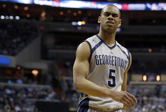 Georgetown guard Markel Starks (5) reacts after a call during the second half of an NCAA college basketball game against Villanova, Monday, Jan. 27, 2014, in Washington. Starks had 20 points in Villanova 65-60 win. (AP Photo/Alex Brandon)