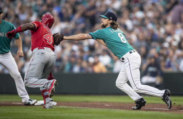 Seattle Mariners' starting pitcher Mike Leake tags out Los Angeles Angels' Luis Rengifo after Leake fielded a ground ball hit by Rengifo during the sixth inning of a baseball game Friday, May 31, 2019, in Seattle. (AP Photo/Stephen Brashear)
