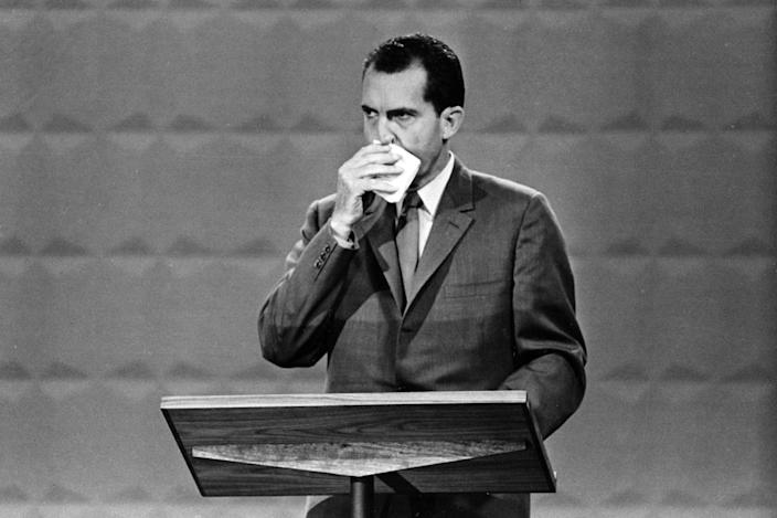A landmark TV moment: Vice President Richard M. Nixon wipes his face with a handkerchief during his awkward debate with Sen. John F. Kennedy in Chicago on Sept. 26, 1960.