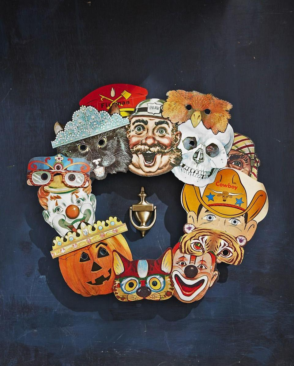 "<p>Don't know what to do with your old Halloween masks? Make them into a unique wreath!</p><p><strong>Make the Mask Wreath: </strong>Source colorful vintage paper masks from websites like Etsy and eBay—you will need 10 to 15 total. Attach to an 18-inch craft ring with a dab of hot-glue, layering and overlapping them as you go.</p><p><a class=""link rapid-noclick-resp"" href=""https://www.amazon.com/Biodegrable-Floral-Center-Ring-Catcher/dp/B07L4672XF/ref=sr_1_2?tag=syn-yahoo-20&ascsubtag=%5Bartid%7C10050.g.22350299%5Bsrc%7Cyahoo-us"" rel=""nofollow noopener"" target=""_blank"" data-ylk=""slk:SHOP CRAFT RINGS"">SHOP CRAFT RINGS</a></p>"