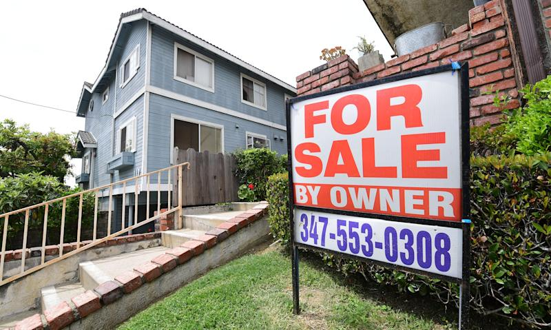 "A ""For Sale by Owner"" sign is posted in front of property in Monterey Park, California on April 29, 2020. - Home prices in the US grew in February to its highest level in over a year heading into the traditional Spring selling season but momentum in the nation's housing market has been reversed due to the coronavirus pandemic. (Photo by Frederic J. BROWN / AFP) (Photo by FREDERIC J. BROWN/AFP via Getty Images)"
