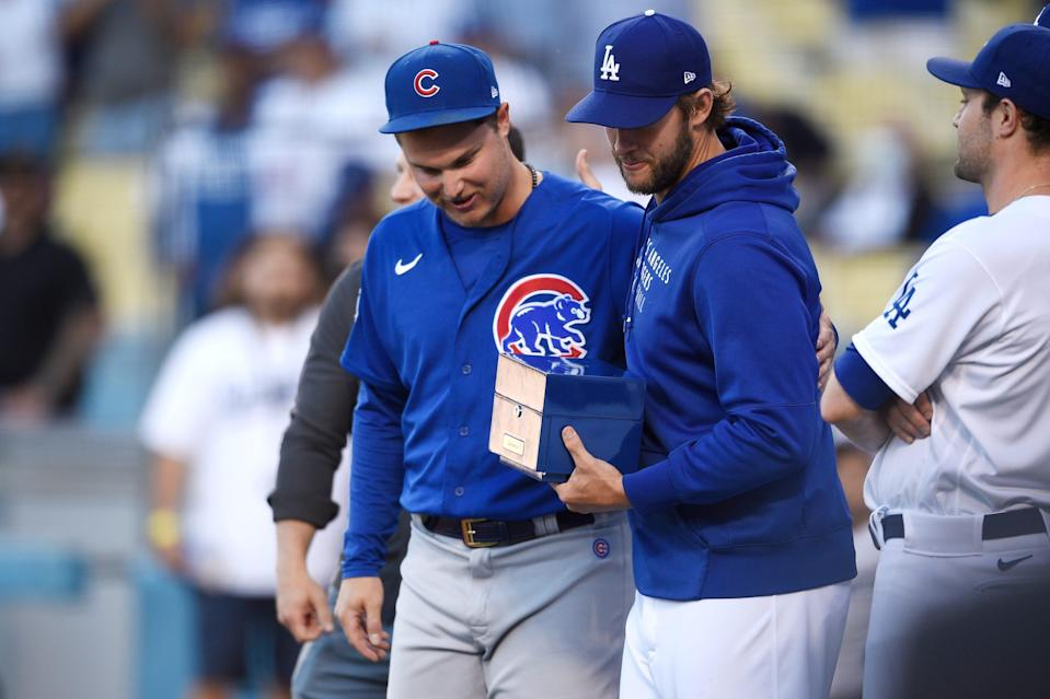 Chicago Cubs' Joc Pederson, left, receives his 2020 World Series ring from Los Angeles Dodgers' Clayton Kershaw before a baseball game in Los Angeles, Thursday, June 24, 2021.