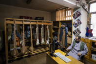 Fighters from the Haqqani network appear inside a room of the Afghanistan National Institute of Music in Kabul, Afghanistan, Thursday, Sept. 16, 2021. The institute was once famous for its inclusiveness and emerged as the face of a new Afghanistan. Now, it is guarded by fighters from the Haqqani network, an ally of the Taliban considered a terrorist group by the United States. (AP Photo/Bernat Armangue)