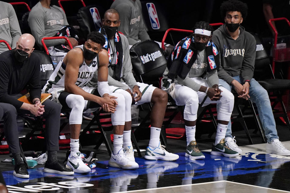 Milwaukee Bucks forward Giannis Antetokounmpo (34) watches from the bench during the fourth quarter of Game 2 of an NBA basketball second-round playoff series, Monday, June 7, 2021, in New York. (AP Photo/Kathy Willens)