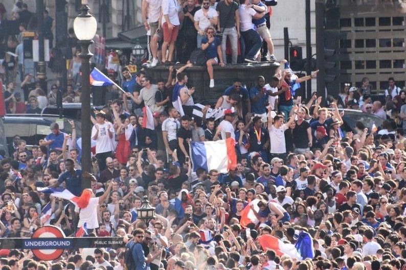 French fans in Piccadilly Circus after their country lifted the World Cup: William Bleeker