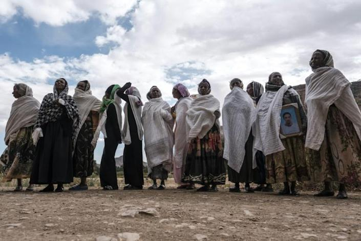 Women gather to mourn the victims of a massacre allegedly perpetrated by Eritrean soldiers in the village of Dengolat, north of Mekele, in February 2021