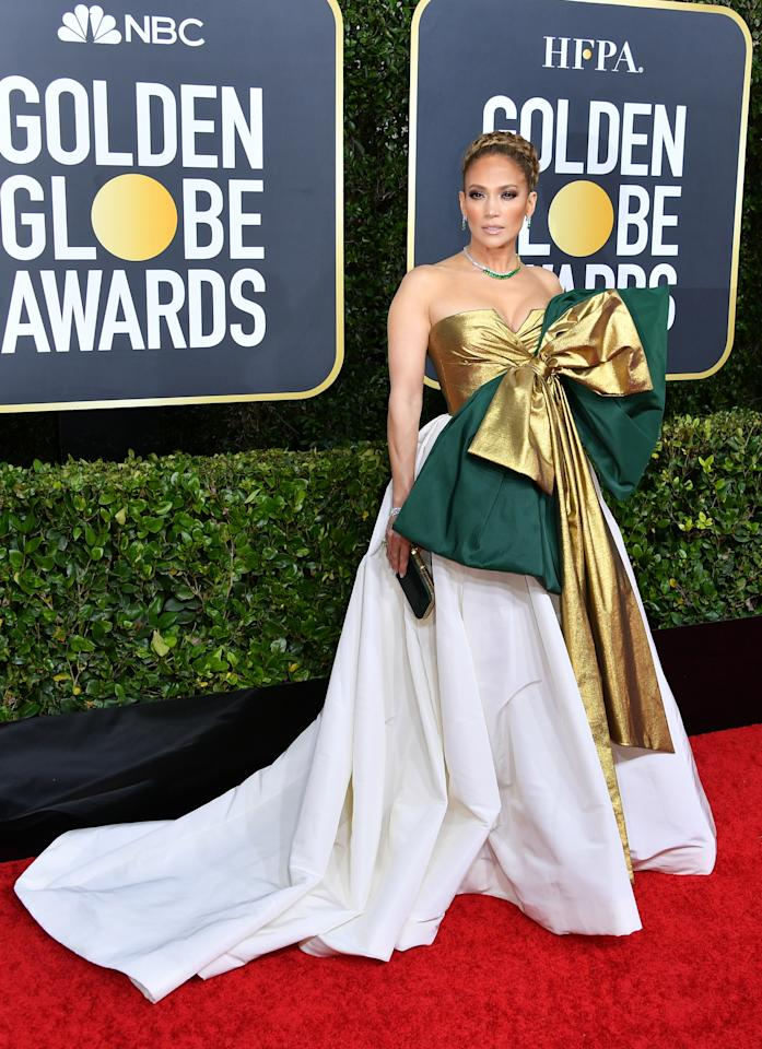 "Lopez hit the red carpet in a bold gown by Valentino to celebrate her nomination for her role in ""Hustlers."" At 50, the triple-threat celeb set the silver screen on fire as a scheming exotic dancer with nothing to lose. (Photo by George Pimentel/WireImage)"