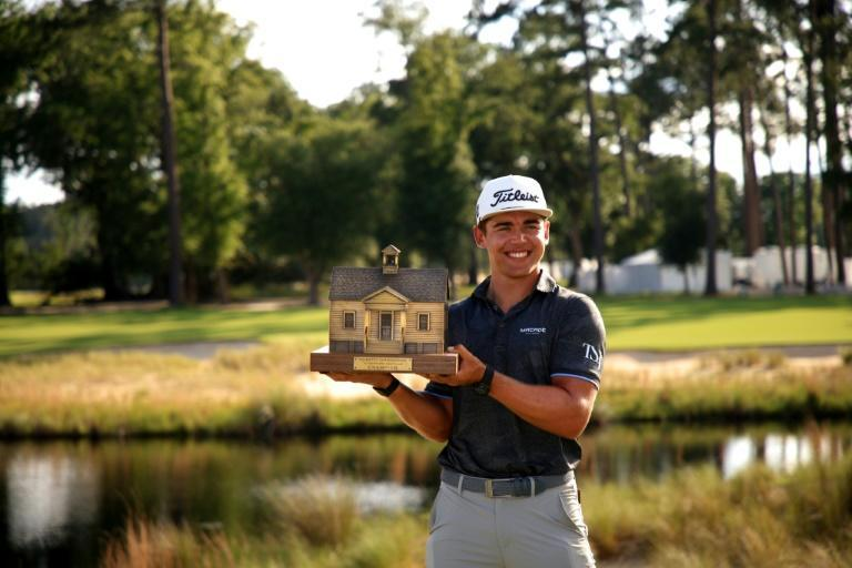 Garrick Higgo of South Africa celebrates with the trophy after winning the Palmetto Championship