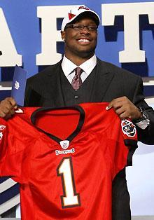Oklahoma defensive tackle Gerald McCoy holds up a jersey after he was selected as the third overall pick by the Buccaneers