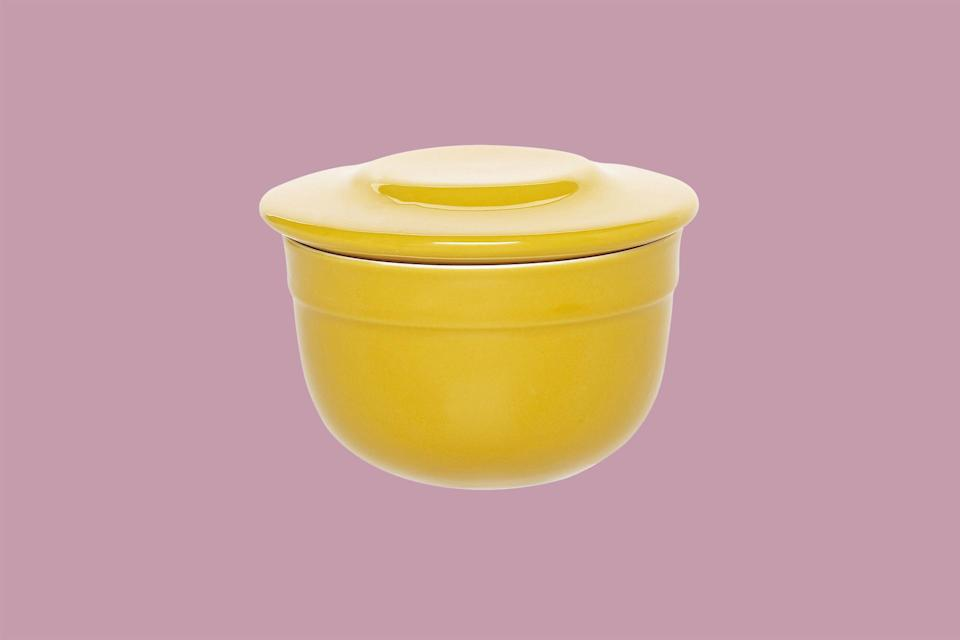"""<p>From Burgundy, France, this ceramic <i>beurrier</i> is made by a family-owned company that has been producing cookware for over 150 years. It is available in eight colors and is dishwasher safe. As a testament to its durability, it comes with a 10-year guarantee.</p> <p><em><strong>Shop Now:</strong> Emile Henry Butter Pot, $49.95, <a href=""""http://surlatable.aiy7.net/c/249354/635796/10190?subId1=MSLWhyEveryHomeCookShouldOwnaButterCrockPlusOurFavoriteOptionsontheMarketRightNowvspence2FooGal7844477202007I&u=https%3A%2F%2Fwww.surlatable.com%2Femile-henry-brick-butter-pot%2FPRO-1752955.html"""" rel=""""nofollow noopener"""" target=""""_blank"""" data-ylk=""""slk:surlatable.com"""" class=""""link rapid-noclick-resp"""">surlatable.com</a>.</em></p>"""