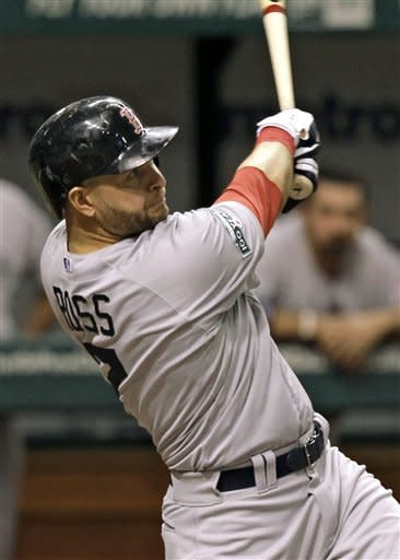 Boston Red Sox's Cody Ross follows the flight of his third-inning home run off Tampa Bay Rays starting pitcher Matt Moore during a baseball game on Thursday, May 17, 2012, in St. Petersburg, Fla. (AP Photo/Chris O'Meara)