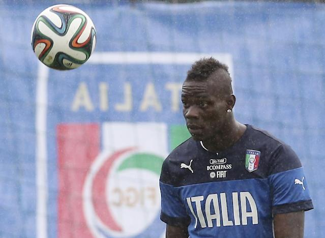 Italy's Mario Balotelli eyes the ball during a training session in the rain, in Mangaratiba, Brazil, Tuesday, June 10, 2014. Italy will play in group D of the Brazil 2014 soccer World Cup. (AP Photo/Antonio Calanni)