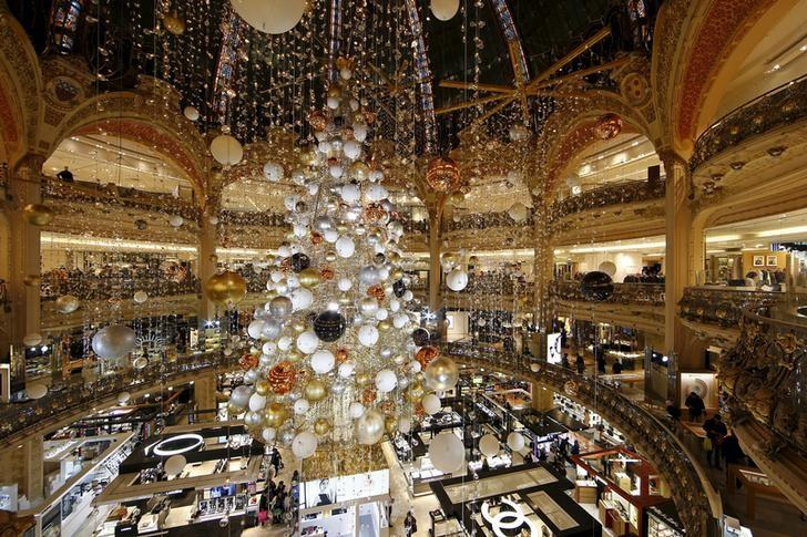 A giant Christmas tree stands in the middle of Galeries Lafayette department store in Paris ahead of the holiday season in the French capital