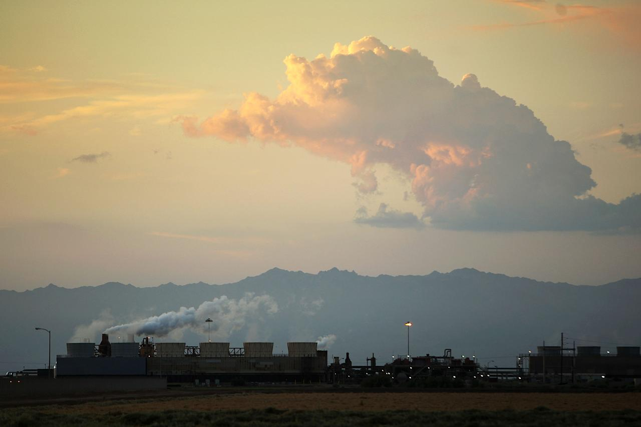"""CALIPATRIA, CA - JULY 6:  A geothermal energy plant taps deep underground heat from the southern San Andreas Fault rift zone near the Salton Sea on July 6 near Calipatria, California. Scientists have discovered that human-created changes effecting the Salton Sea appear to be the reason why California's massive """"Big One"""" earthquake is more than 100 years overdue and building up for the greatest disaster ever to hit Los Angeles and Southern California. Researchers found that strands of the San Andreas Fault under the 45-mile long rift lake have have generated at least five 7.0 or larger quakes about every 180 years. This ended in the early 20th century when authorities stopped massive amounts of Colorado River water from periodically flooding the into this sub-sea level desert basin. Such floods used to regularly trigger major quakes and relieve building seismic pressure but the last big earthquake on the southern San Andreas was about 325 years ago. Dangerous new fault branches that could trigger a 7.8 quake have recently been discovered under the Salton Sea.  (Photo b David McNew/Getty Images)"""