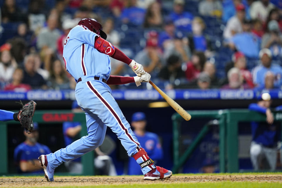Philadelphia Phillies' Didi Gregorius hits a two-run single against Chicago Cubs pitcher Manuel Rodriguez during the sixth inning of a baseball game, Thursday, Sept. 16, 2021, in Philadelphia. (AP Photo/Matt Slocum)
