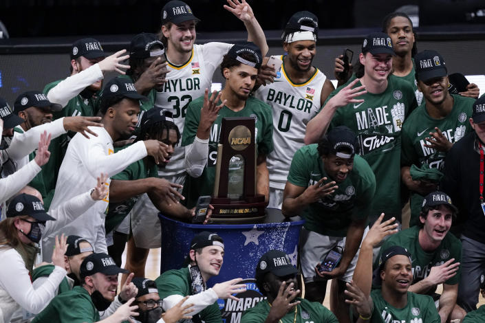Baylor players celebrate after an Elite 8 game against Arkansas in the NCAA men's college basketball tournament at Lucas Oil Stadium, Tuesday, March 30, 2021, in Indianapolis. Baylor won 81-72. (AP Photo/Michael Conroy)