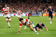 """A massive game saw Japan take another major scalp - running out 28 - 21 winners - and top their group with four wins out of four. Here, Stu Forster (Getty Images) captures Yu Tamura running in Japan's third try. He says: """"Yu Tamura had already scored two tries when he managed to get away from the Scottish defensive line. I used my EF 70-200mm f/2.8L IS III USM as he approached to touch down. I shot the photograph wide so that you can see the elation on the faces of his Japanese teammates and the dejection of Stuart Hogg of Scotland."""""""