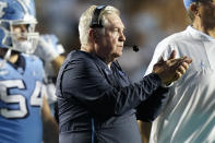 North Carolina coach Mack Brown applauds during the second half of the team's NCAA college football game against Virginia in Chapel Hill, N.C., Saturday, Sept. 18, 2021. (AP Photo/Gerry Broome)