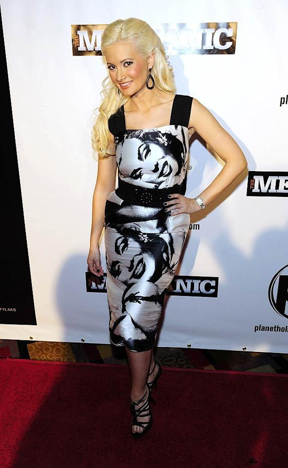 """Is it just us, or have you also noticed that Holly Madison's wardrobe has taken a major hit ever since she parted ways with her former beau, Hugh Hefner, and headed for Vegas? Needless to say, you can definitely tell that the former """"Girls Next Door"""" star is no longer shopping on Rodeo Drive. Steven Lawton/<a href=""""http://www.filmmagic.com/"""" target=""""new"""">FilmMagic.com</a> - January 26, 2011"""