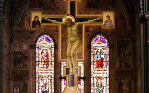A 5.40-meter-high wooden crucifix painted by italian artist Giotto between 1288 and 1290 is seen on display in Florence's Santa Maria Novella church - Credit: AP/FABRIZIO GIOVANNOZZI