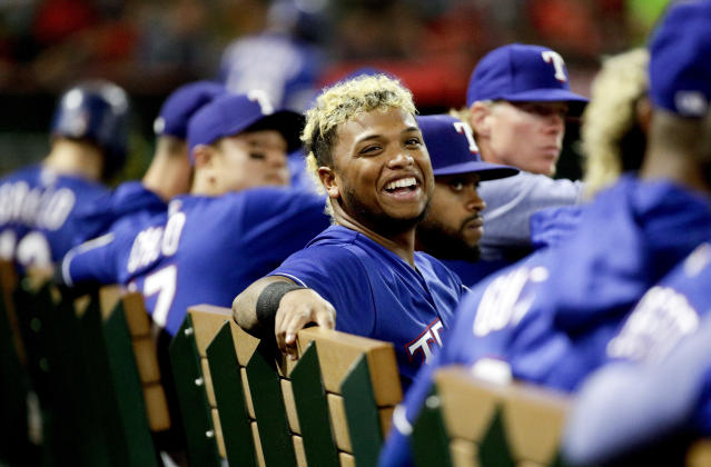Texas Rangers left fielder Willie Calhoun smiles on the bench during the sixth inning of a baseball game against the Los Angeles Angels in Anaheim, Calif., Monday, Sept. 24, 2018. (AP Photo/Chris Carlson)