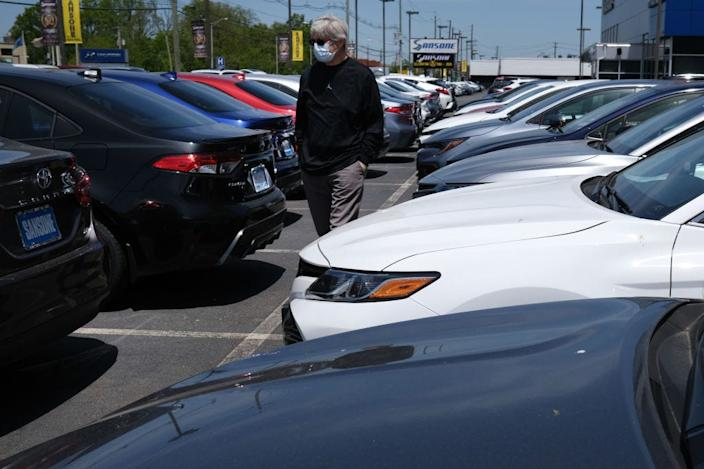 A car buyer shops for a vehicle in New Jersey after the state began to re-open.