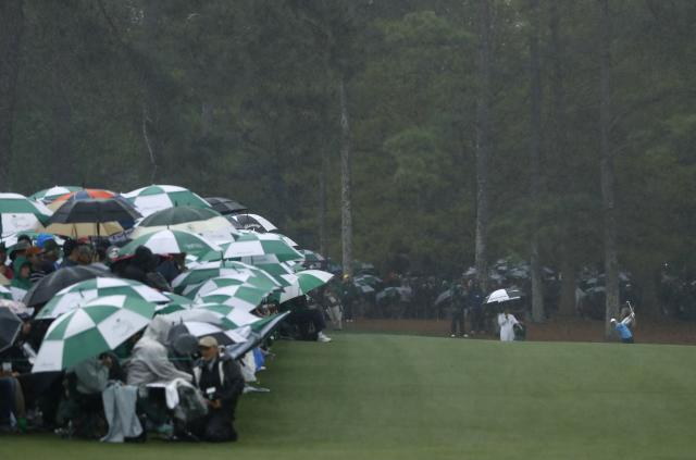 Rory McIlroy of Northern Ireland hits on the 13th fairway in the rain during third round play of the 2018 Masters golf tournament at the Augusta National Golf Club in Augusta, Georgia, U.S. April 7, 2018. REUTERS/Mike Segar