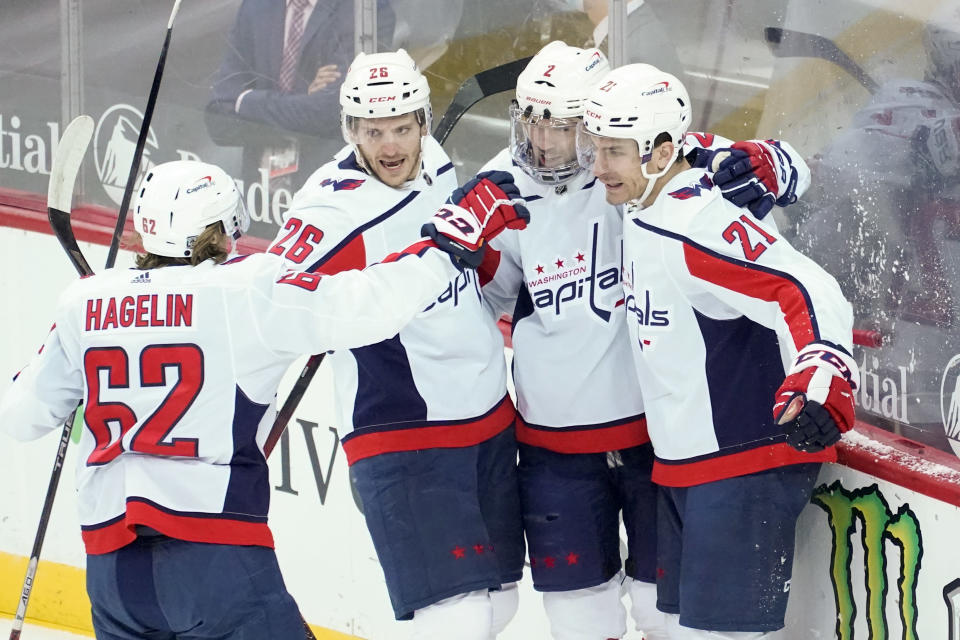 Washington Capitals right wing Garnet Hathaway (21) celebrates after scoring a goal during the first period of an NHL hockey game against the New Jersey Devils, Saturday, Feb. 27, 2021, in Newark, N.J. (AP Photo/Mary Altaffer)