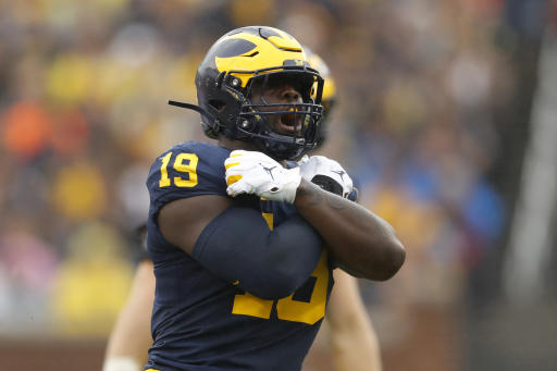 Michigan's Paye returning for senior year, puts National Football League on hold