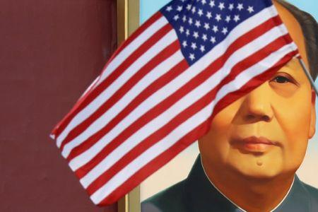 U.S. flag flutters in front of a portrait of late Chinese Chairman Mao at Tiananmen gate during the visit by U.S. President Trump to Beijing
