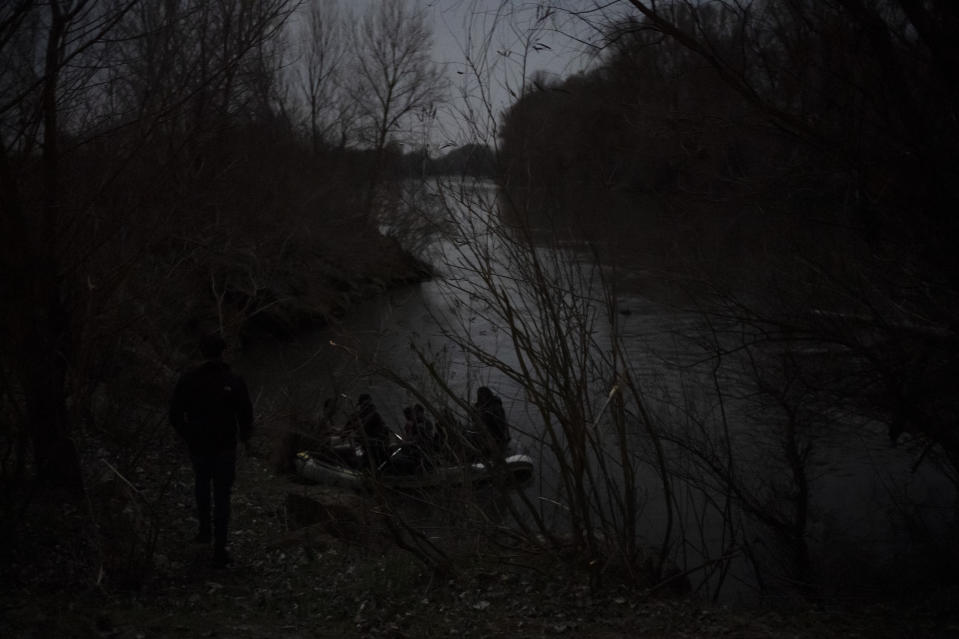 File - In this late Sunday, March 8, 2020, file photo migrants use an inflatable boat in the Maritsa river in an attempt to enter Greece from Turkey near Edirne, Turkey. The European Union's border and coast guard is under pressure following a series of allegations that it was involved in illegal pushbacks of migrants. Frontex is an increasingly powerful agency that monitors the 27-nation bloc's external borders. (AP Photo/Felipe Dana, File)