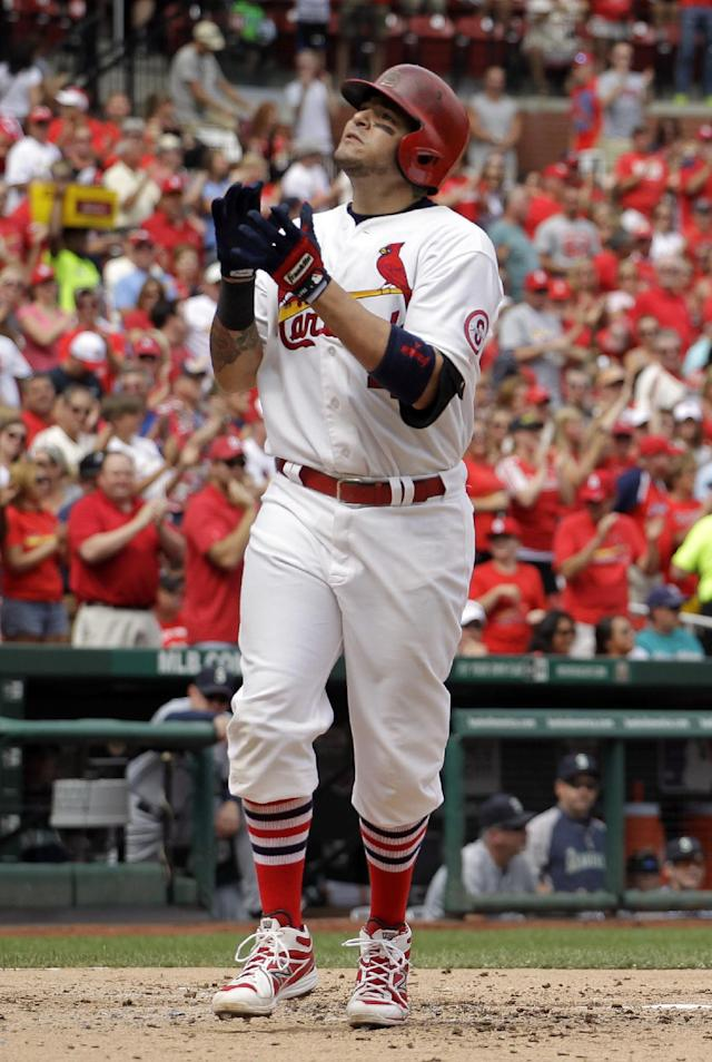 St. Louis Cardinals' Yadier Molina celebrates as he reaches home after hitting a solo home run during the second inning of a baseball game against the Seattle Mariners Sunday, Sept. 15, 2013, in St. Louis. (AP Photo/Jeff Roberson)