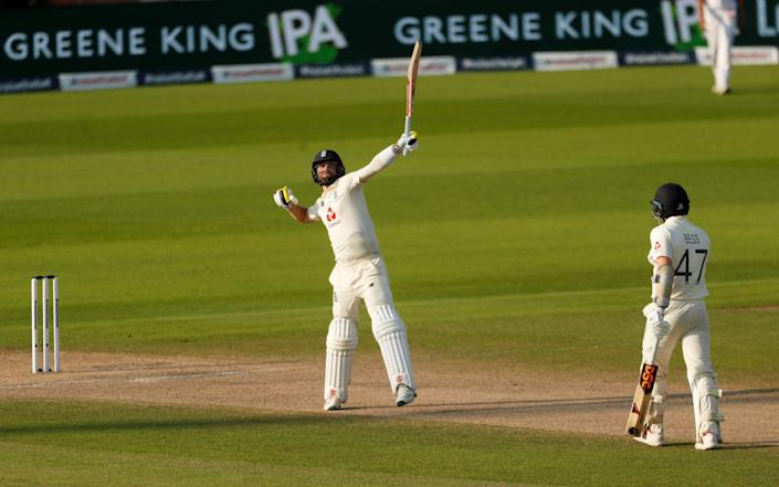 Chris Woakes celebrates after edging the winning runs through the slips - Reuters