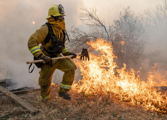 A firefighter from San Matteo helps fight the Kincade Fire in Sonoma County, Calif., on Sunday, Oct. 27, 2019. (Photo: Ethan Swope/AP)