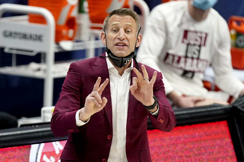 Alabama head coach Nate Oats directs his players against LSU during the first half of the championship game at the NCAA college basketball Southeastern Conference Tournament Sunday, March 14, 2021, in Nashville, Tenn. (AP Photo/Mark Humphrey)