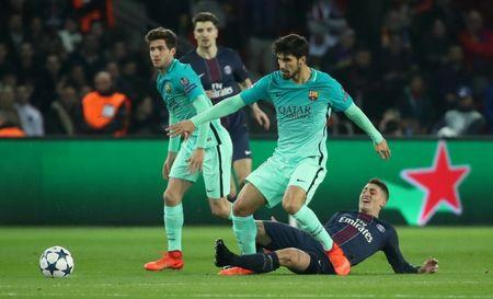Barcelona's Andre Gomes in action with Paris Saint-Germain's Marco Verratti
