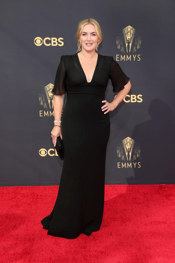 """<p>The Oscar-winner and """"Mare of Easttown"""" actress in a timeless black gown with sheer sleeves.<em> (Image via Getty Images)</em></p>"""
