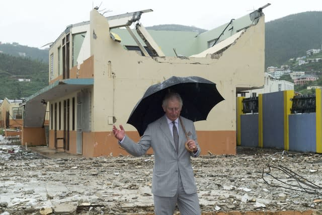 Hurricanes are an annual threat in the Caribbean and the Prince of Wales surveys the British Virgin Islands in November 2017 following a major storm. Arthur Edwards/The Sun