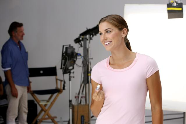 IMAGE DISTRIBUTED FOR CHAPSTICK - ChapStick kicks off a new era for the brand with soccer star and Olympic gold medalist, Alex Morgan, on Tues., Oct. 8, 2013 in Los Angeles. Morgan, the brand's newest spokesperson, shows off her healthy lips on the Los Angeles set of her first shoot with the iconic brand. (Photo by Casey Rodgers/Invision for ChapStick/AP Images)