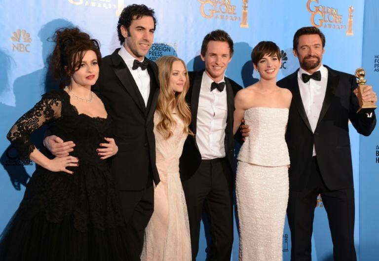 """Sacha Baron Cohen (2nd from L) appeared with (L-R) Helena Bonham Carter, Amanda Seyfried, Eddie Redmayne, Anne Hathaway and Hugh Jackman in the 2012 film adaptation of the musical """"Les Miserables"""""""