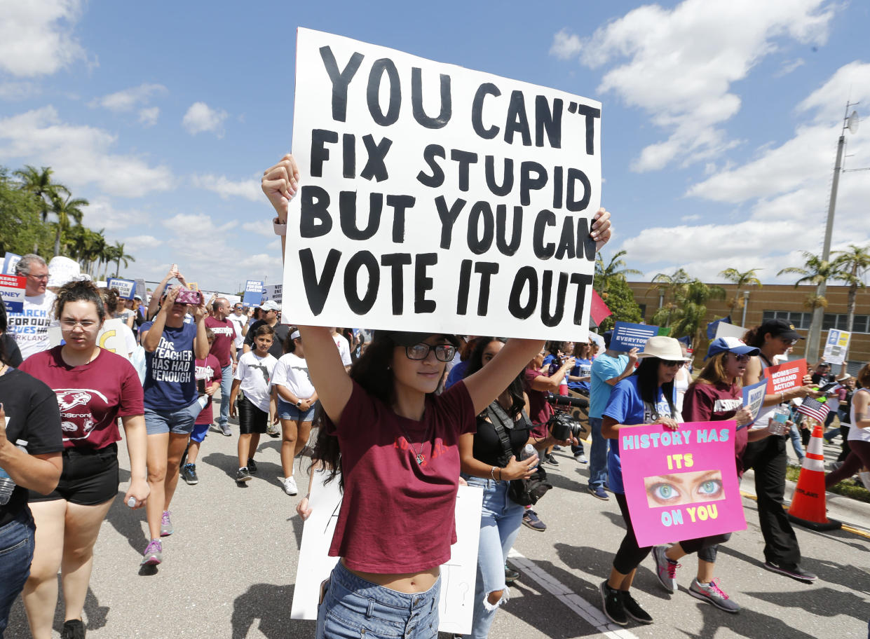 "Protesters take part in a ""March for Our Lives"" rally in Parkland, Fla., last March. (Photo: Joe Skipper/AP)"