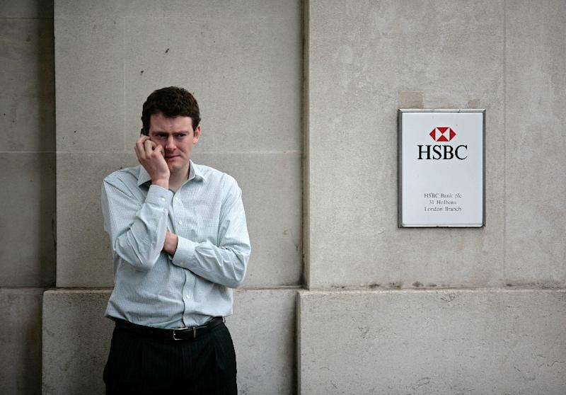 A man uses his mobile phone outside an HSBC bank branch in London (AFP Photo/Shaun Curry)