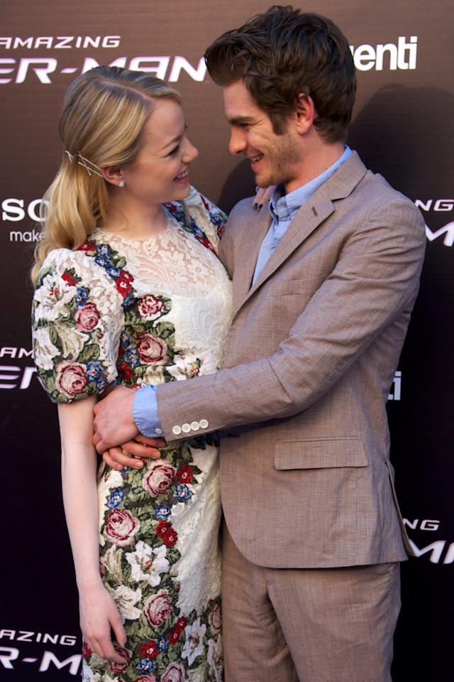 """MADRID, SPAIN - JUNE 21:  Actor Andrew Garfield and actress Emma Stone attend """"The Amazing Spider-Man"""" premiere at Callao cinema on June 21, 2012 in Madrid, Spain.  (Photo by Carlos Alvarez/Getty Images)"""