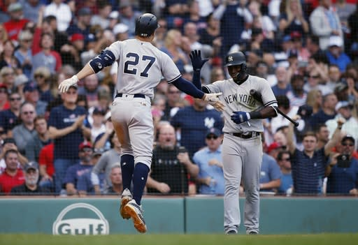 New York Yankees' Giancarlo Stanton celebrates his solo home run against the Red Sox on Saturday. (AP)