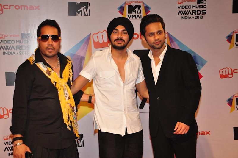 MUMBAI, INDIA - MARCH 21: Indian Bollywood singers Rahul Vaidya (R) and Mika Singh (L) with his nephew Gurdeep during the MTV Video Music Awards 2013 at Tulip Star Hotel, Juhu Tara Road on March 21, 2013 in Mumbai, India. (Photo by Amlan Dutta/Hindustan Times via Getty Images)