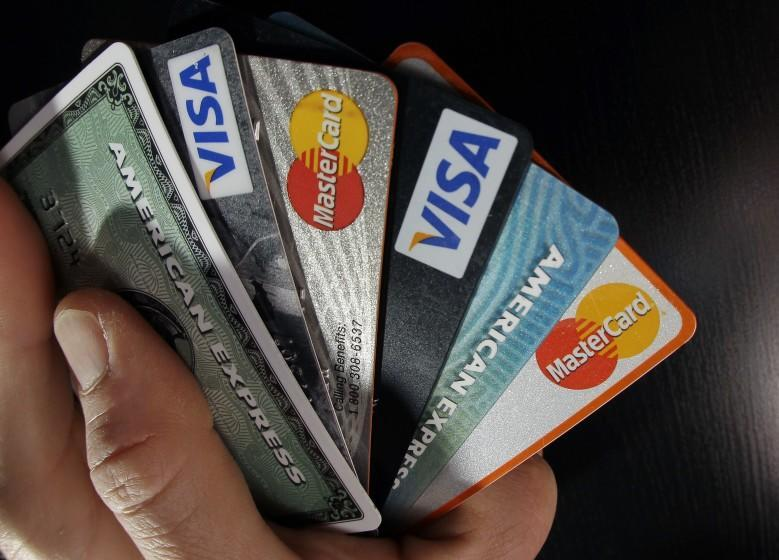 FILE - In this March 5, 2012, file photo, consumer credit cards are posed in North Andover, Mass. The three largest credit reporting agencies will change the way they handle records in a major revamp long sought by consumer advocates. The changes were announced Monday, March 9, 2015, after talks between Equifax, Experian, TransUnion and New York Attorney General Eric Schneiderman. (AP Photo/Elise Amendola, File)