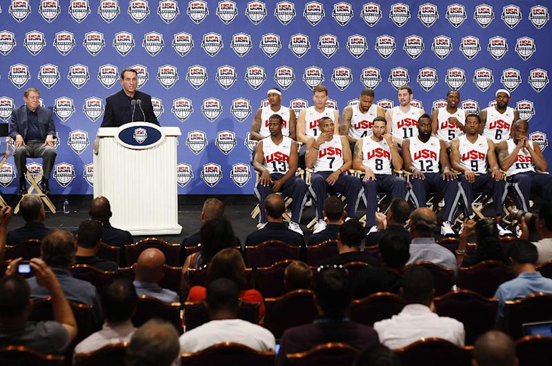 Coach Mike Krzyzewski, left, speaks during the USA men's basketball national team news conference announcing the final roster in Las Vegas on Saturday, July 7, 2012. (AP Photo/Las Vegas Review-Journal, Jason Bean)