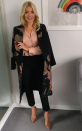 """<p>Holly draped a floral jacquard-effect coat from <a rel=""""nofollow noopener"""" href=""""http://www.whistles.com/women/clothing/limited-collection/floral-jacquard-coat-26105.html?dwvar_floral-jacquard-coat-26105_size=04&utm_source=google_shopping&utm_medium=cpc&utm_term=.&utm_campaign=&utm_content=sy35Nh9RB_dc pcrid  pkw  pmt  pid 26105_Pink%2FMulti_04 &gclid=EAIaIQobChMIkoyZ44ug1wIVZpPtCh1xRw5cEAQYASABEgLuzfD_BwE"""" target=""""_blank"""" data-ylk=""""slk:Whistles"""" class=""""link rapid-noclick-resp"""">Whistles</a> over a silky shirt by Theory for one episode. She teamed the look with trousers from Whistles and nude <a rel=""""nofollow noopener"""" href=""""https://www.harrods.com/en-gb/gianvito-rossi/gianvito-pumps-105-p000000000005285805?colour=Brown&dco=GB&pcu=GBP&cid=Shopping_UK_GGL_Gianvito_Rossi_P000000000005285805_Brown_IT%2040&_cclid=v3_e1f4c38f-b9db-535a-b0ec-f467c78017f0&gclid=EAIaIQobChMI2PKQuIyg1wIV6rDtCh1zmgLnEAYYASABEgK79fD_BwE"""" target=""""_blank"""" data-ylk=""""slk:heels"""" class=""""link rapid-noclick-resp"""">heels</a> by Gianvito Rossi. </p>"""