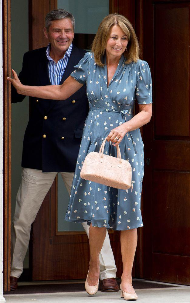 Michael and Carole Middleton after visiting Prince George after he was born in July 2013